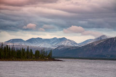 Clouds over the mountains and big lake. Royalty Free Stock Images