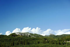 Clouds over the mountains on the island of Corfu Stock Photography