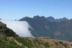 Clouds over the mountains maideira. Clouds over the mountains Madeira, Portugal Stock Photography