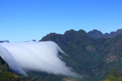 Clouds over the mountains maideira. Clouds over the mountains Madeira, Portugal Royalty Free Stock Photography