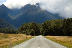 Clouds over the mountains in New Zealand Stock Images