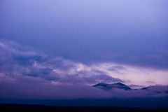 Clouds over Mountains. Purple hued clouds over mountain range in Colorado Royalty Free Stock Photos