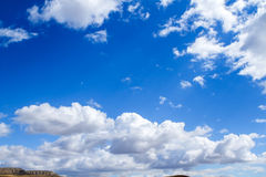 Clouds over mountains royalty free stock photos
