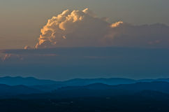 Clouds over mountains between sunset and twilight, Sithonia Stock Photo
