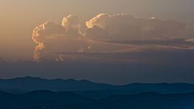 Clouds over mountains between sunset and twilight, Sithonia Stock Photography