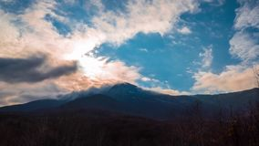 Clouds over mountains, time lapse, 4k stock footage