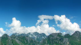 Clouds over mountains time lapse stock footage