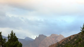 Clouds over the mountains. Zoom.  Pamir, Tajikist Stock Image