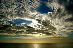 Clouds over the ocean Stock Photography
