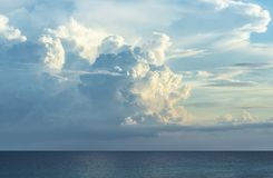 Clouds over ocean with incoming storm. Photograph taken late afternoon with incoming thunderstorm over ocean royalty free stock photos