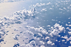 Clouds over the ocean seen from an airplane Royalty Free Stock Images
