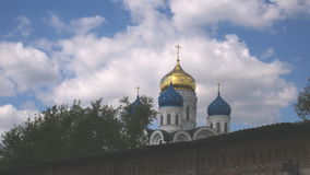 Clouds over orthodox church. Timelapse stock video