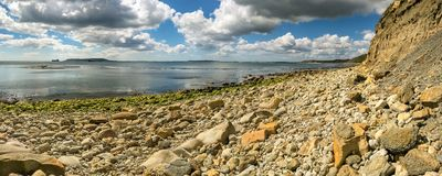 Osmington Bay, Jurassic Coast, Dorset, UK. Clouds over Osmington Bay, with the Isle of Portland in the background, Osmington Mills near Weymouth, Jurassic Coast Stock Photography