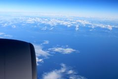 Flying over the Pacific Ocean Royalty Free Stock Photos