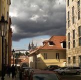 Clouds over Prague. View of St. Vitus Cathedral Prague Castle, Czech Republic, Prague from the side of a small alley royalty free stock photo