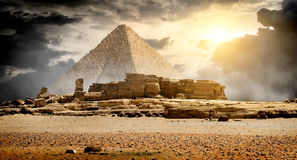 Clouds over pyramid. Storm clouds over pyramid of Cheops in Giza Stock Photo