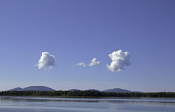 Clouds over Raccoon Cove Maine Royalty Free Stock Photography