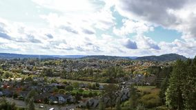 Clouds over residential houses in Happy Valley Or zooming out in Fall 1080p video. HD 1080p movie of white clouds and blue sky over residential subdivision stock video footage