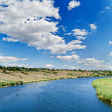 Clouds over river Stock Photography
