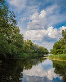 Clouds over the river. Beautiful clouds over the water calm river royalty free stock images