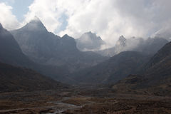 Clouds over rocky mountains, Himalaya, Nepal Stock Images