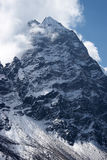 Clouds over rocky unclimbed Peak 5939, Himalaya Royalty Free Stock Image