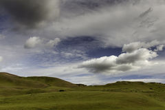 Clouds over the Rolling Hills in the Spring Stock Images