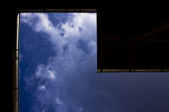 Clouds over roof Stock Images