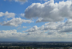Clouds over San Gabriel Valley. San Gabriel Valley in Los Angeles County during a clear visual day with lush clouds Stock Photo