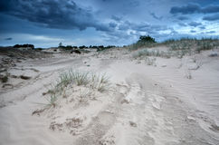 Clouds over sand dunes in Netherlands Stock Images