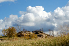 Clouds over sand dunes at Warren State Park. A beautiful landscape of clouds, dunes and grass at warren dunes state park in Bridgman  Michigan USA Stock Photo