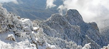 Clouds over the Sandias panorama seven. True wide panorama of the heavy clouds of the first snowstorm of the winter hovering over the Sandia Mountains near Royalty Free Stock Photography