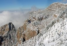 Clouds over the Sandias panorama six. True wide panorama of the heavy clouds of the first snowstorm of the winter hovering over the Sandia Mountains near Royalty Free Stock Image