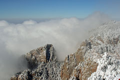 Clouds over the Sandias panorama two. True wide panorama of the heavy clouds of the first snowstorm of the winter hovering over the Sandia Mountains near Stock Photo