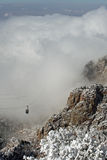 Clouds over the Sandias Tram. The heavy clouds of the first snowstorm of the winter hovering over the Sandia Mountains near Albuquerque, New Mexico, with ice and Royalty Free Stock Images