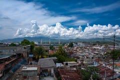 Clouds over Santiago de Cuba harbour Stock Photos