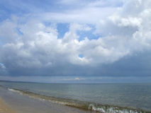 Clouds over the sea. Seascape - beach and clouds over the sea royalty free stock photo