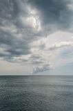 Clouds over the sea. Alusta Blue water Royalty Free Stock Photos