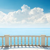 Clouds over sea and balcony Royalty Free Stock Image