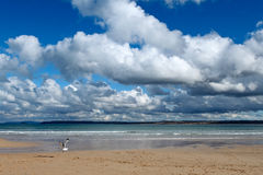 Clouds over the sea in St. Ives, Cornwall UK. White clouds over the sea in St. Ives, Cornwall UK Stock Photo