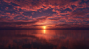 Clouds over the sea at sunset. Royalty Free Stock Photo