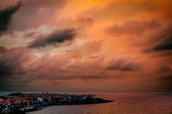 Clouds over the sea at sunset. Dramatic clouds over the sea at sunset in sozopol, bulgaria Royalty Free Stock Photos