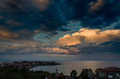 Clouds over the sea at sunset. Dramatic clouds over the sea at sunset in sozopol, bulgaria Stock Photo