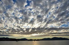 Clouds over sea waters at sunrise, Marseilles, France stock photography