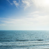 Clouds over sea with waves Stock Photo