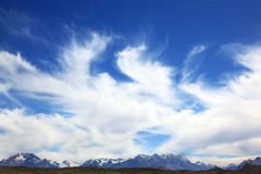 The clouds over snow-capped mountains. A huge deserted National Park Perito Moreno in Patagonia, Argentina. Strong wind turns the clouds over snow-capped Royalty Free Stock Photography