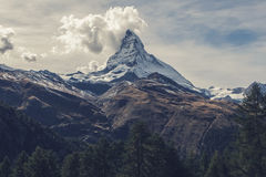 Clouds over snow capped peak Royalty Free Stock Photography