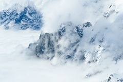 Clouds over snow mountains Royalty Free Stock Photo