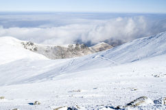 Clouds over snow winter mountain, Bulgaria Royalty Free Stock Image