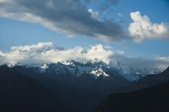 Clouds over the snowcapped mountains, Himalayas, Uttarakhand, In Royalty Free Stock Photo